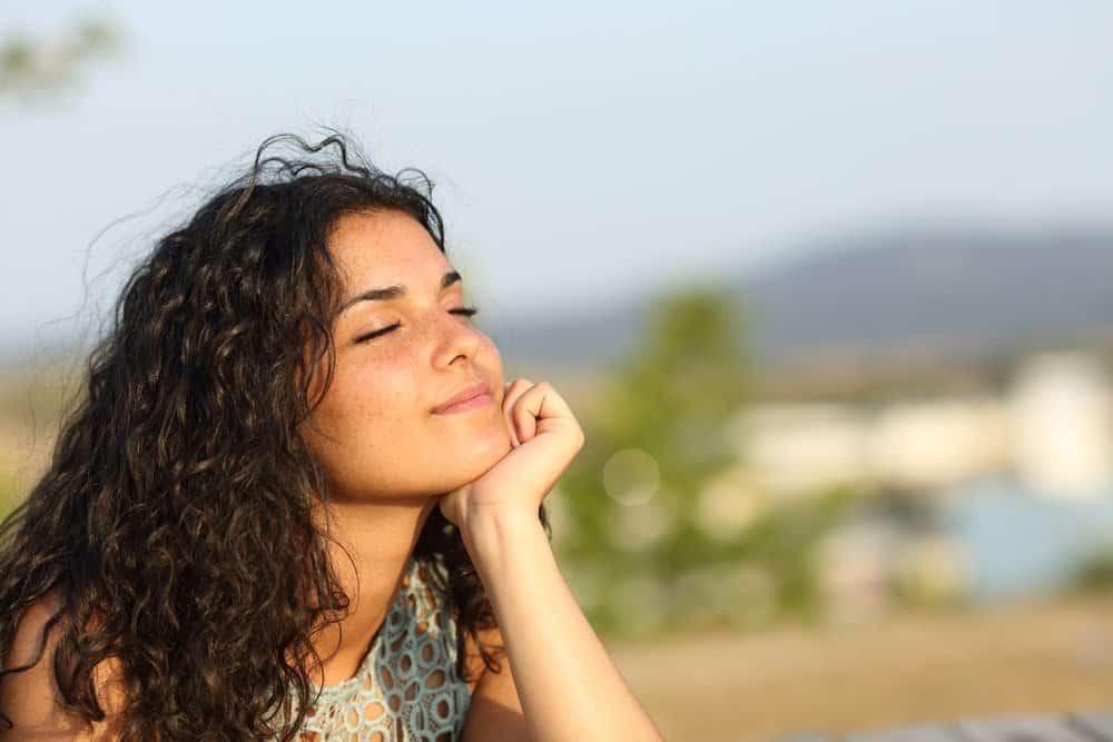girl face in sun mindful