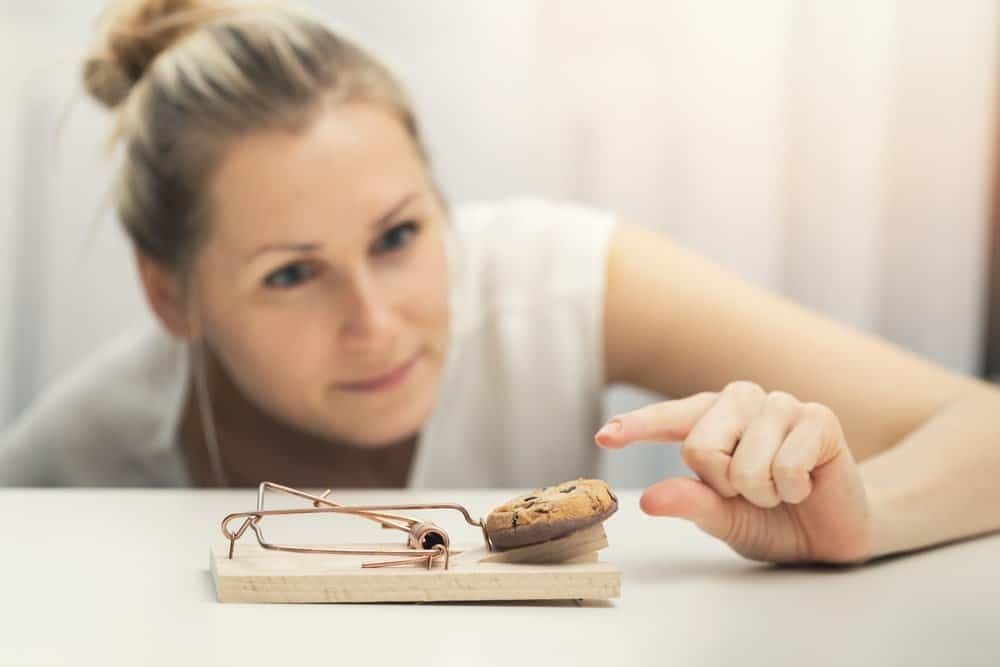 hungry woman with cookie
